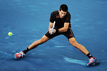 Serbia's Novak Djokovic plays a double handed backhand return against Spain's Daniel Gimeno-Traver during their second round match at the Madrid Open on Tuesday