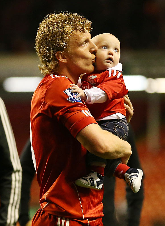 Liverpool's Dirk Kuyt celebrates with his kid after the victory against Chelsea on Tuesday