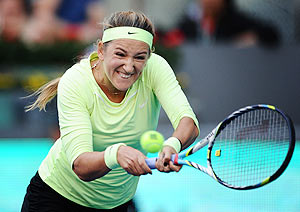 Belarus's Victoria Azarenka plays a double handed backhand against Serbia's Ana Ivanovic during the Madrid Open on Wednesday