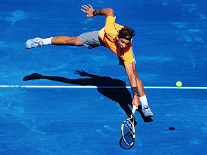 Rafael Nadal of Spain plays a backhand during his 3rd round match against Nikolay Davydenko of Russia