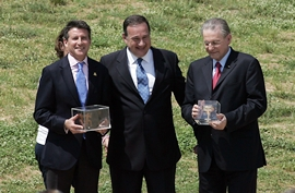 Photograph: LOCOG Chairman Lord Sebastian Coe, Spyros Capralos, President of Hellenic Olympic Committe, and IOC president Dr Jacques Rogge attend the London 2012 Olympic Torch during the Lighting Ceremony of the Olympic Flame at Ancient Olympia. Milos Bicanski/Getty Images
