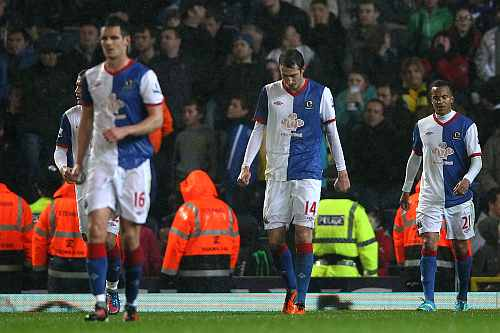 Radosav Petrovic of Blackburn Rovers and his team mates look dejected after conceding a goal during the Barclays Premier League match