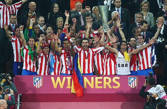 Atletico Madrid players celebrate with the trophy afer defeating Athletic Bilbao in  their UEFA Europa League final on Wednesday