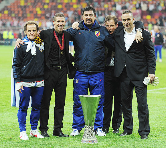 Atletico Madrid Coach Diego Simeone celebrates with his coaching staff after winning the Europa League final on Wednesday