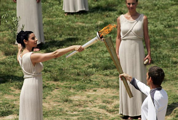 High Priestess Ino Menegaki lights the London 2012 Olympic Torch during the Lighting Ceremony of the Olympic Flame at Ancient Olympia on May 10, 2012 in Olympia, Greece
