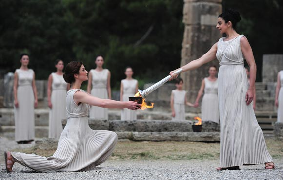 High Priestess Ino Menegaki lights the Olympic flame at the Temple of Hera during the Lighting Ceremony of the Olympic Flame at Ancient Olympia on May 10, 2012 in Olympia, Greece