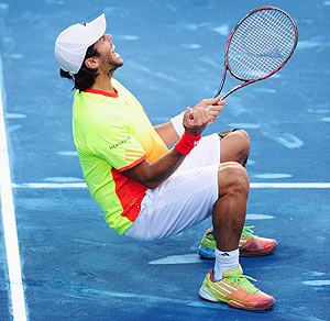 Spain'S Fernando Verdasco collapses in celebration after defeating compatriot Rafael Nadal during their 4th round tie of the Madrid Masters