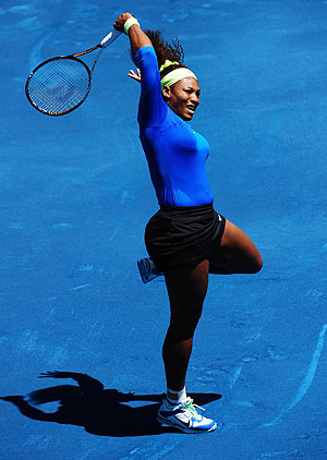 Serena Williams returns to Caroline Wozniacki during their match at the Madrid Open on Thursday