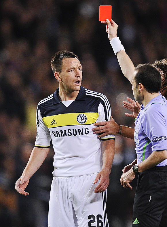 Chelsea captain John Terry (left) reacts as he is shown a red card by referee Cuneyt Cakir
