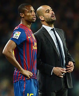 Head coach Josep Guardiola (right) of FC Barcelona follows the game as he brings on Seydou Keita