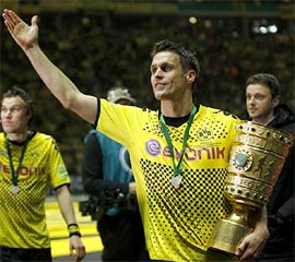 Borussia Dortmund's captain Sebastian Kehl holds up the trophy