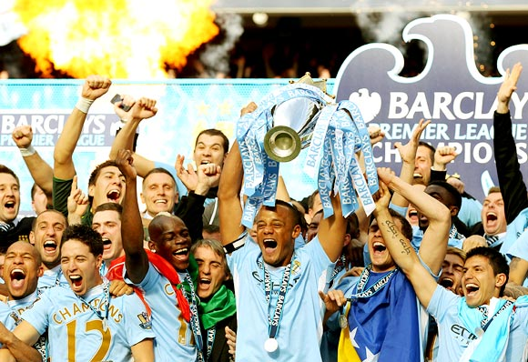 Manchester City players celebrate winning the English Premier League