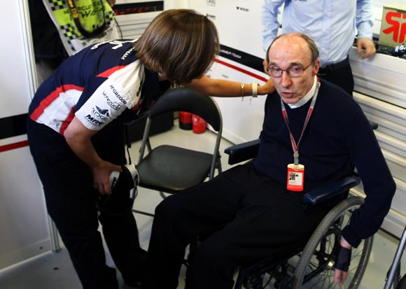 Sir Frank Williams talks with his daughter Claire Williams