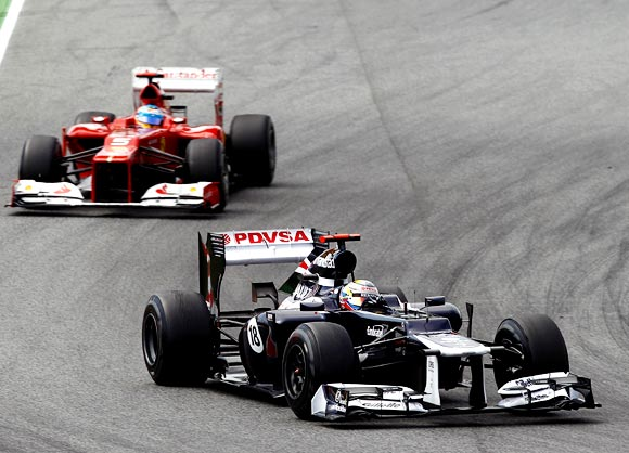 Williams driver Pastor Maldonado leads the Spanish Grand Prix ahead of Ferrari's Fernando Alonso