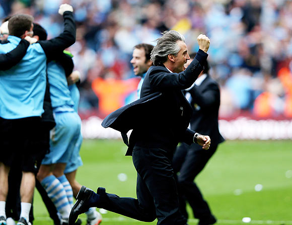Roberto Mancini the manager of Manchester City celebrates