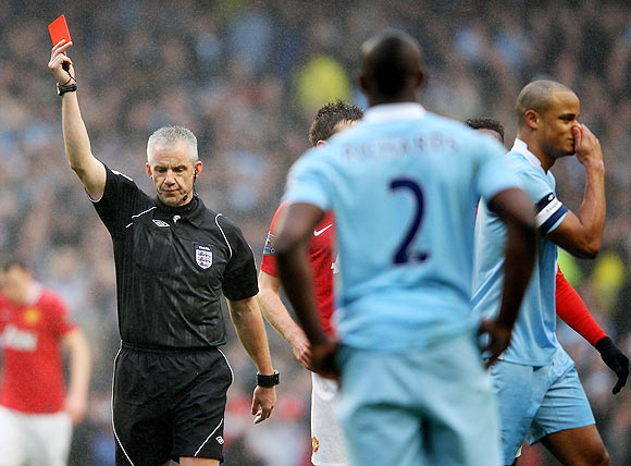 Referee Chris Foy sends off Vincent Kompany of Manchester City