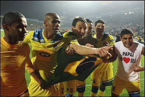 APOEL Nicosia players celebrate after winning a match