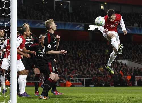 Arsenal's Laurent Koscielny scores a goal against AC Milan