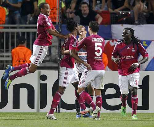 Lyon players celebrate after winning their game