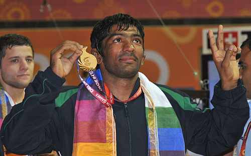 Yogeshwar Dutt displays the gold he won at the Commonwealth Games
