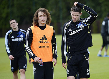 Chelsea's David Luiz (left) and teammate Gary Cahill at a team practice session
