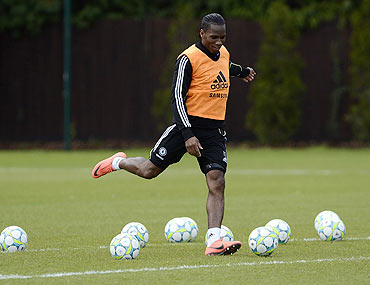 Chelsea's Didier Drogba shoots at goal during a team practice session