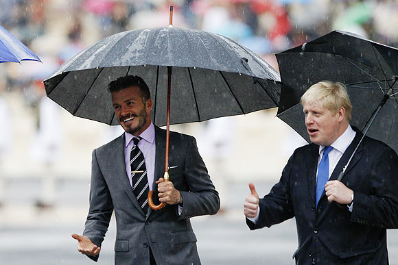 British soccer player David Beckham (left) and London's Mayor Boris Johnson enter the Panathenaic stadium before the Olympic Flame handover ceremony in Athens on Thursday