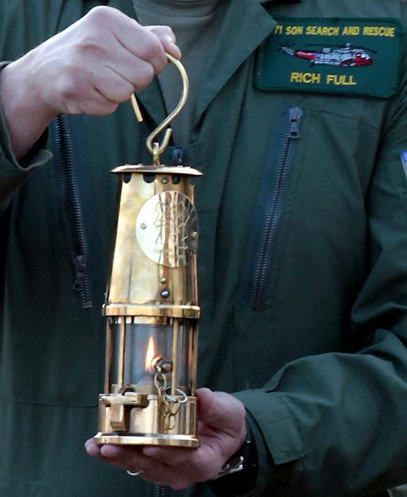 Lieutenant commander Richie Full delivers the Olympic Flame from RNAS Culdrose at Lands End