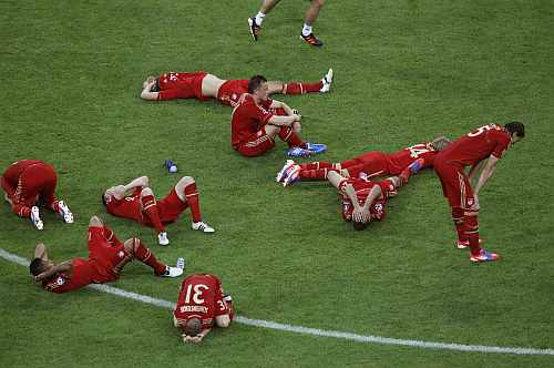 Players of Bayern Munich react after losing their Champions League final soccer match against Chelsea at the Allianz Arena in Munich