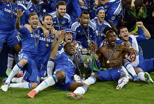 Chelsea's players celebrate with the trophy after their Champions League final match against Bayern Munich at the Allianz Arena in Munich
