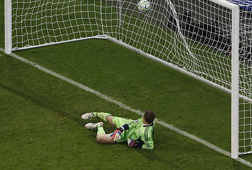 Bayern Munich's goalkeeper Neuer fails to make a penalty save