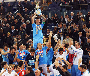Paolo Cannavaro captain of Napoli holds the trophy