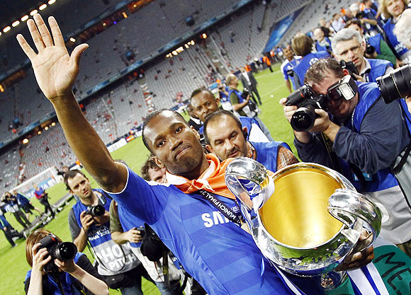 Chelsea's Didier Drogba celebrates with the trophy