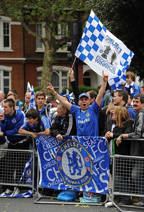 Chelsea fans wait for the Chelsea victory parade following their UEFA Champions League and F.A. Cup victories