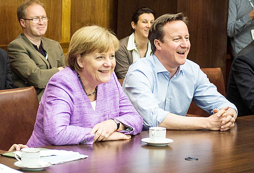 German Chancellor Angela Merkel and British Prime Minister David Cameron watch the UEFA Champions League Final between FC Bayern Muenchen and Chelsea FC