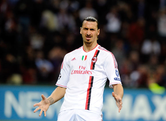 Zlatan Ibrahimovic of AC Milan reacts during the UEFA Champions League quarter final first leg match between AC Milan and Barcelona at Stadio Giuseppe Meazza on March 28, 2012 in Milan