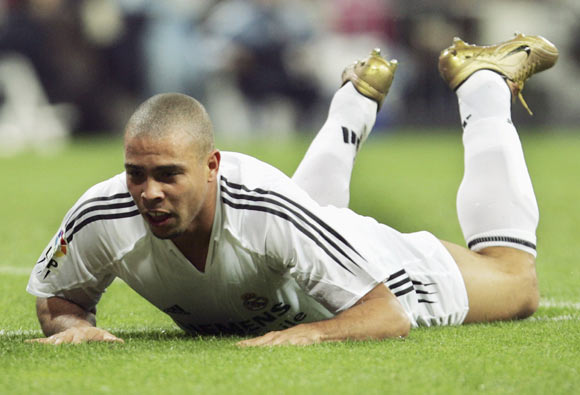 Real Madrid's Ronaldo slides on the ground after missing a shot during a La Liga match at The Bernabeu, on October 31, 2004 in Madrid