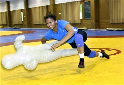 Wrestler Geeta Phogat practises using a training dummy at the Netaji Subhas National Institute of Sports in Patiala