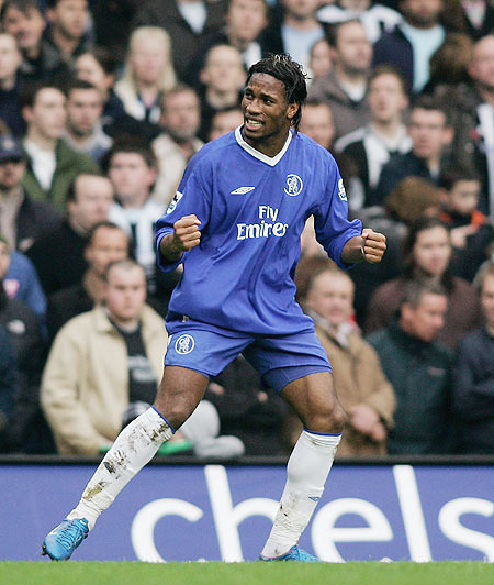 Didier Drogba celebrates after scoring a goal in 2004