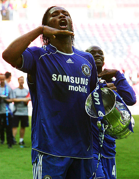 Didier Drogba of Chelsea celebrates with the trophy following the FA Cup Final against Manchester United at the Wembley Stadium in 2007