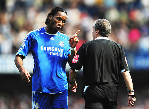 Didier Drogba of Chelsea gestures towards referee Alan Wiley in 2008