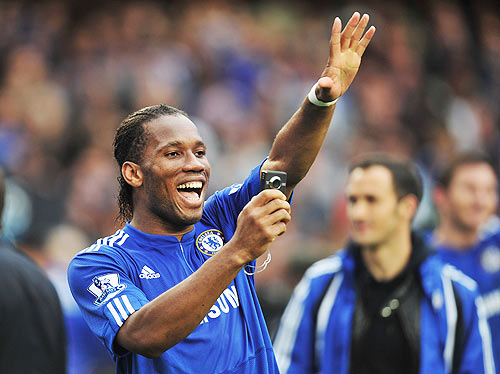 Didier Drogba of Chelsea takes a photograph on his mobile phone as he celebrates winning the title after the Barclays Premier League at Stamford Bridge in 2010