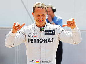 Michael Schumacher of Mercedes GP celebrates setting the fastest time before his five place grid penalty during qualifying for the Monaco GP