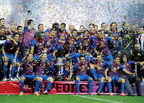 Barcelona players celebrate with the Copa del Rey trophy after beating Athletic Bilbao 3-0 on Friday