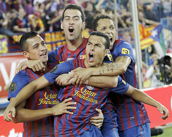 Barcelona's Pedro Rodriguez celebrates with teammates Alexis Sanchez , Sergio Busquets and Adriano after scoring the winner against Athletic Bilbao during their Spanish King's Cup final