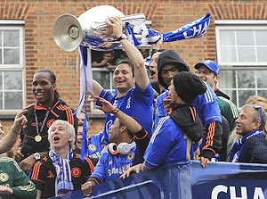 Chelsea's Frank Lampard (centre) holds the Champions League trophy near owner Roman Abramovich (right) during their victory parade in west London
