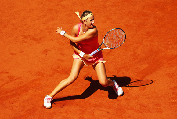 Victoria Azarenka of Belarus in action in her women's singles second round match against Dinah Pfizenmaier of Germany