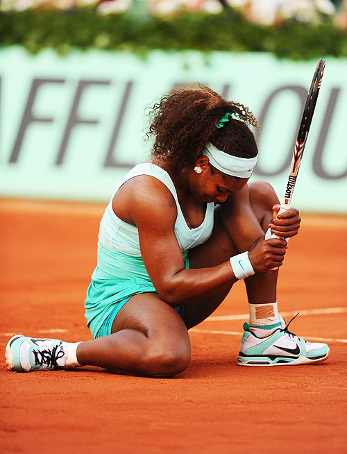 Serena Williams of USA slumps to the floor