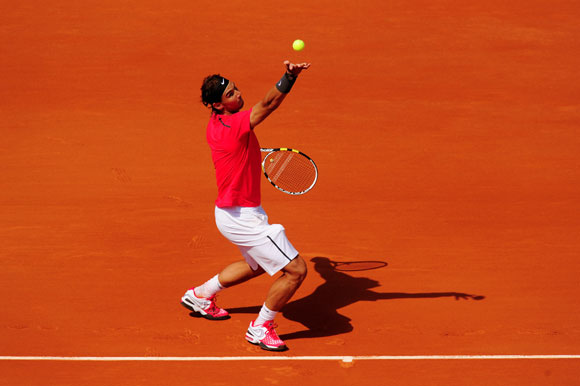 Rafael Nadal of Spain serves in his men's singles first round match against Simone Bolelli of Italy during day 3 of the French Open at Roland Garros