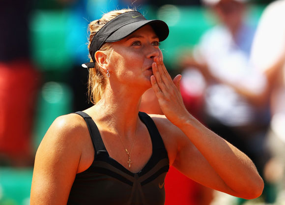 Maria Sharapova of Russia celebrates victory in her women's singles first round match against Alexandra Cadantu of Romania